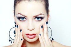 Woman with brightly blue eyes Stock Photography