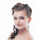 Jewelry. Glamorous Smiling Brunette with Brilliant Earrings. Sophistication Stock Photo