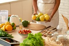 Bringing fruits to the table royalty free stock photo
