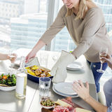 Woman bringing dish to the table Royalty Free Stock Photo