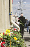 Woman Bringing Flowers to Oktyabrskaya Station Stock Photo