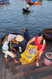 A Woman is bringing fresh fishes upstair to a local seafood market in Vinh Luong port Stock Image