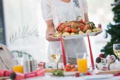 Free Woman Bringing Roast Chicken At Table Royalty Free Stock Photography - 33385657