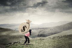 Woman brings sack of dollar money Royalty Free Stock Photo