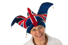 Woman with Brittain funny hat Royalty Free Stock Image