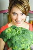 Woman with broccoli Stock Photo
