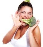 Woman and broccoli Stock Photo
