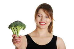 Woman with broccoli Stock Photography