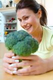 Woman with brocolli. Yong woman with fresh brocolli Royalty Free Stock Photo