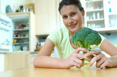 Woman with brocolli. Yong woman with fresh brocolli Stock Photo