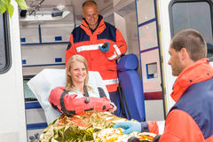 Woman with broken arm in ambulance paramedics. Accident helping victim royalty free stock photo