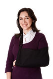 Woman with broken arm in sling Royalty Free Stock Photography