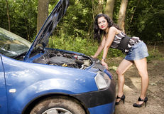 Woman with broken car Royalty Free Stock Photos