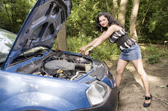 Woman with broken car Royalty Free Stock Image