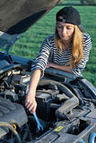 Woman at broken car Royalty Free Stock Photography