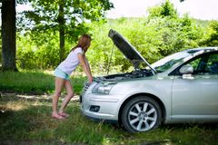 Woman with broken car Royalty Free Stock Photography