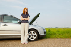 Woman with a broken car Stock Images