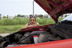 Woman and broken car Royalty Free Stock Photos