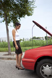 Woman and broken car Stock Photo