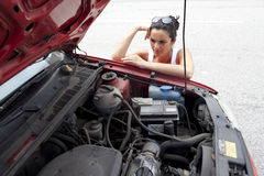 Woman and broken car Stock Images