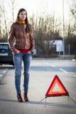Woman with broken car. Seeking help Stock Photography