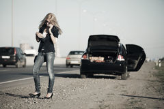 Fashion woman at the broken car outdoor Royalty Free Stock Images
