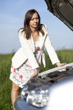 Woman and broken car Royalty Free Stock Image