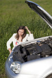 Woman and broken car Stock Image