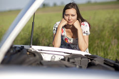 Woman and broken car Royalty Free Stock Photo