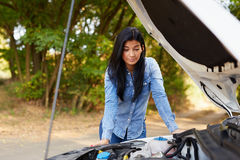 Woman with a broken car. Angry young woman with a broken car Royalty Free Stock Images