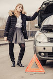 Woman, broken car and auto triangle on road Stock Photos