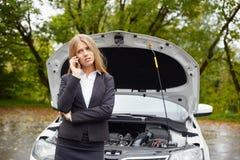 Woman with a broken car Stock Photos