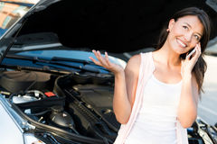 Woman with broken car Stock Photos