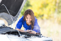 Woman with a broken car Stock Photography