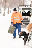 Woman broken car man gas can snow. Woman broken car men gas can snow assistance winter mechanic Stock Photography