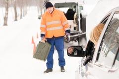 Woman broken car man gas can snow. Woman broken car men gas can snow assistance winter mechanic Royalty Free Stock Photography