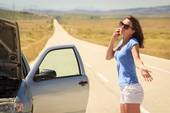 Woman with  broken car on the road calling for help Royalty Free Stock Photo