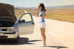 Woman with  broken car on the road calling for help Stock Photography