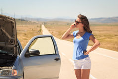 Woman with  broken car on the road calling for help Royalty Free Stock Photos