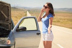 Woman with  broken car on the road calling for help Stock Photo