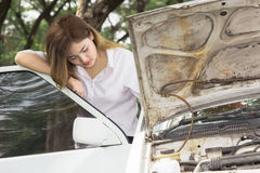 Woman with broken car Stock Images