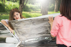 Woman with broken car. On the road waiting for help Royalty Free Stock Photos