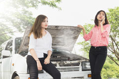Woman with broken car. On the road waiting for help Royalty Free Stock Photo