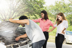 Woman with broken car. On the road waiting for help Stock Images