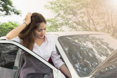 Woman with broken car Stock Image