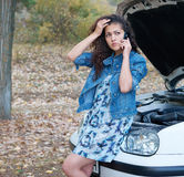 Woman with broken car talk on phone Royalty Free Stock Photo