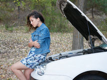 Woman with broken car wait on road Stock Photography