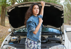 Woman with broken car wait on road Royalty Free Stock Image