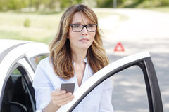 Woman with broken down car Stock Images