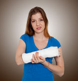 Woman with broken hand. In Bandage stock photo